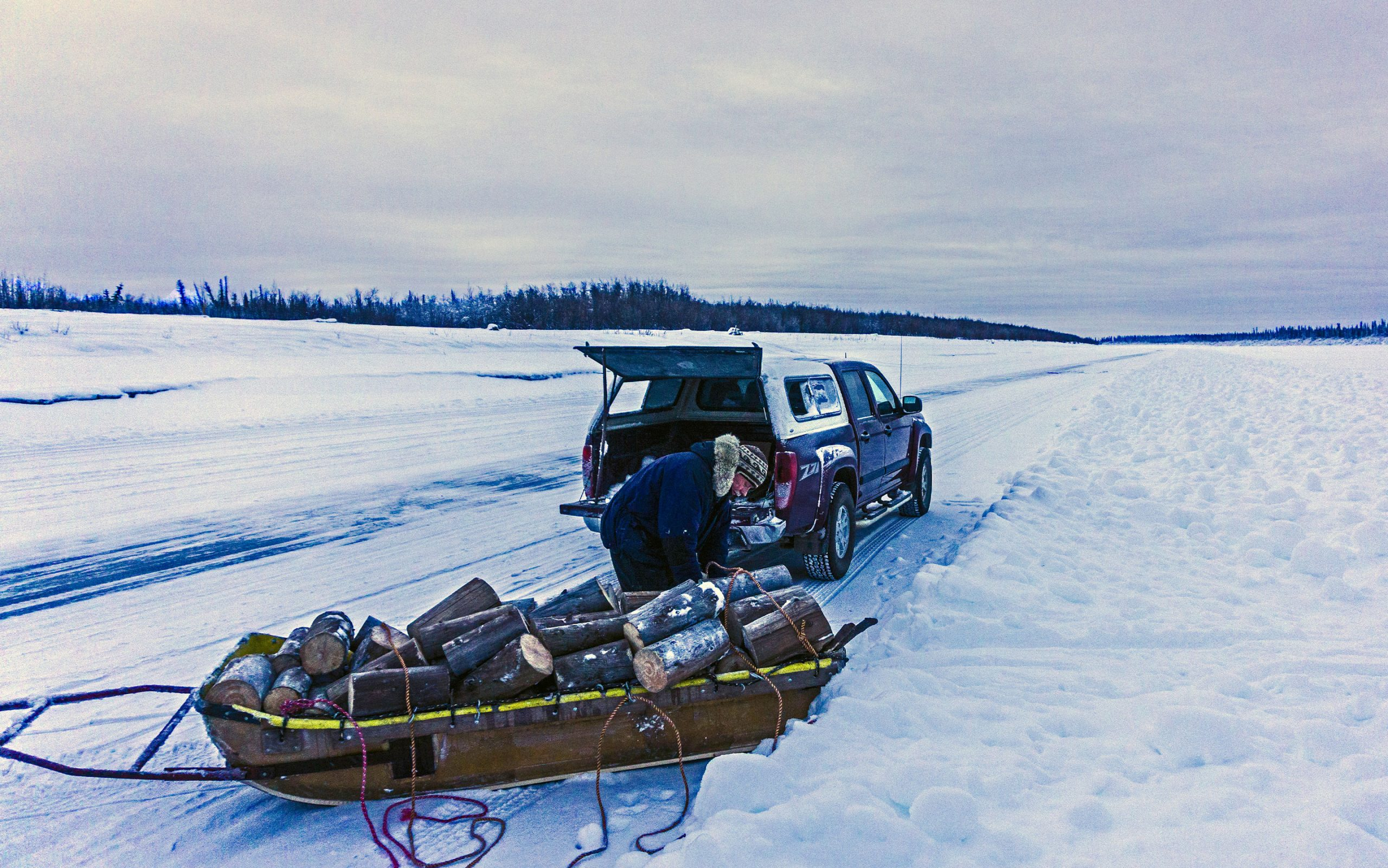 Missionary-loads-a-sled-with-wood